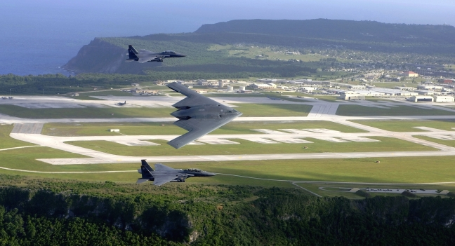 A U.S. Air Force B-2 Spirit and two F-15E Strike Eagle fly in formation over Andersen Air Force Base, Guam.  (U.S. Air Force photo by Tech. Sgt. Cecilio Ricardo)